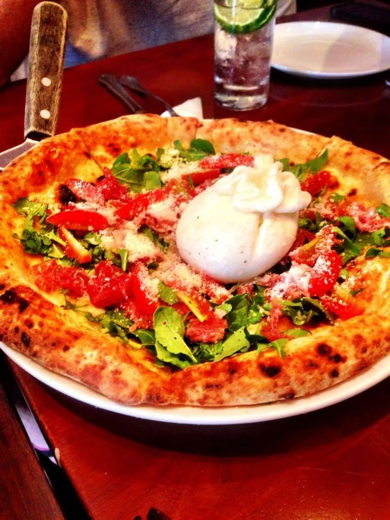 Is this not the best looking pizza ever?!  Pizza 4P's signature Burrata Prosciutto pizza.